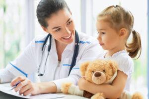 doctor examining achild in ahospital