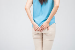 Woman has Diarrhea Holding her Butt: Isolated on White Background
